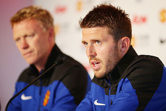 Michael Carrick (right) speaks to the media as Manchester United manager David Moyes looks on during a Manchester United press conference at Museum of Contemporary Art on in Sydney, Australia, on Friday