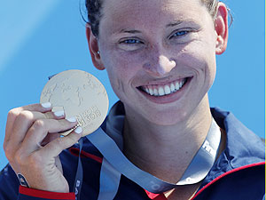 Winner Haley Danita Anderson of the U.S. holds her gold medal after the women's 5km open water race during the World Swimming Championships in Barcelona on Saturday