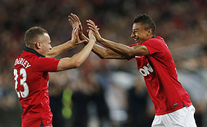 Manchester United's Jesse Lingard (right) celebrates with teammate Tom Cleverley after scoring against A-League All Star XI during their friendly match in Sydney on Saturday
