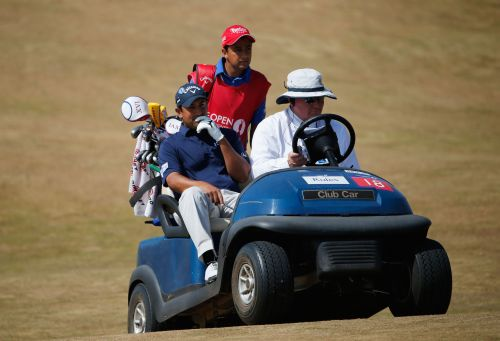Shiv Kapur of India gets a ride back to the 6th green during the third round