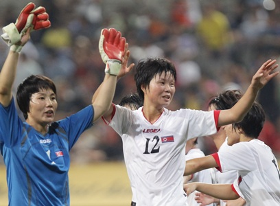 North Koreans get warm reception in South, win match