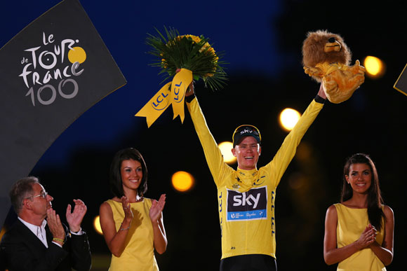 Winner of the 2013 Tour de France, Chris Froome of Great Britain and SKY Procycling celebrates on the podium