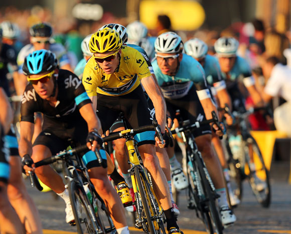 Chris Froome of Great Britain and SKY Procycling (C) rides in the wheel of teammate Richie Porte of Australia during the twenty first and final stage of the 2013 Tour de France