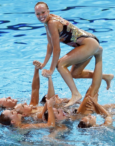 Canada's team performs in the synchronised swimming free combination routine