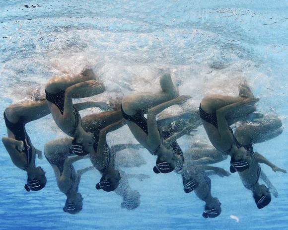 Spain's team are seen underwater as they perform in the synchronised swimming free combination routine