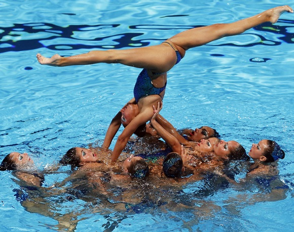 Greece's team perform in the synchronised swimming