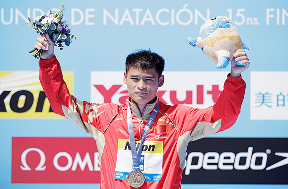 Gold medallist Li Shixin of China celebrates after winning the Men's 1m Springboard Diving final on day three of the 15th FINA World Championships at Piscina Municipal de Montjuic in Barcelona on Monday