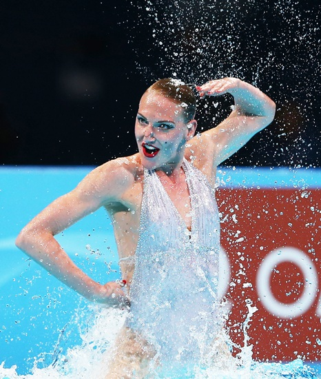 Svetlana Romashina of Russia competes in the Synchronized Swimming Solo Free final