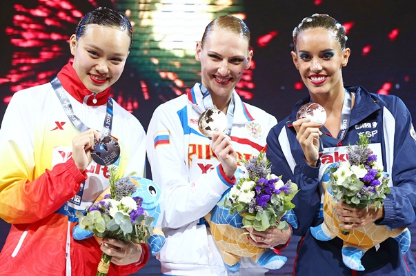 (From left) Silver medallist Huang Xuechen of China, gold medallist Svetlana Romashina of Russia and bronze medallist Carbonell Ballestero of Spain
