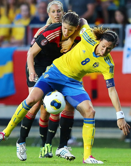 Lotta Schelin (8) of Sweden and Annike Krahn (back) of Germany battle for the ball during the UEFA Women's Euro 2013 semi final match