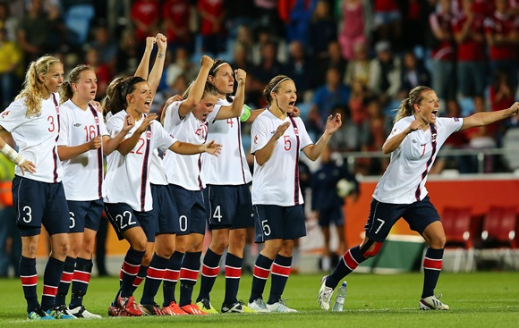 Team members of Norway celebrate after winning the UEFA Women's Euro 2013 semifinal match