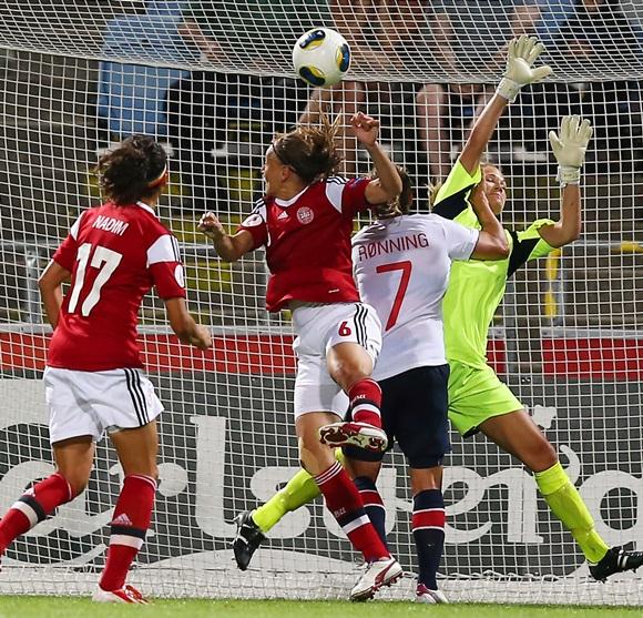 Marianne Knudsen (centre) of Denmark heads her team's equalizing goal