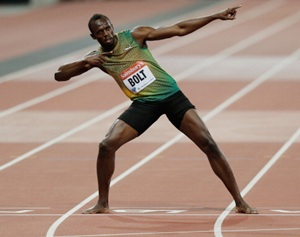 Usain Bolt celebrates after winning