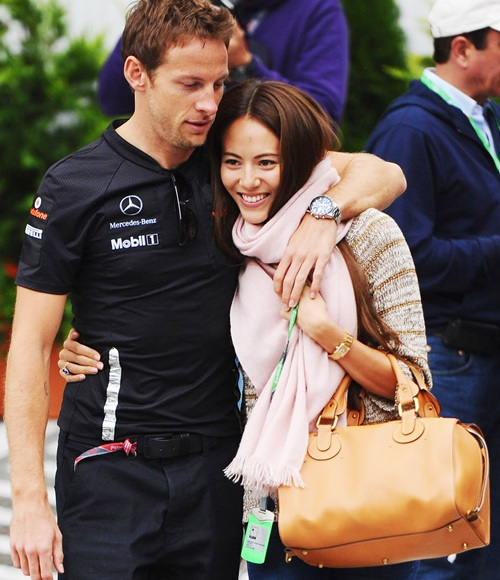 Jenson Button of Great Britain and McLaren and his girlfriend Jessica Michibata