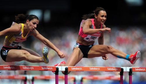 Nadine Hildebrand of Germany and Jessica Ennis-Hill of Great Britain compete in the Women's 100m Hurdles during day two of the Sainsbury's Anniversary Games - IAAF Diamond League 2013 at The Queen Elizabeth Olympic Park