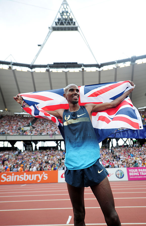 Mo Farah of Great Britain celebrates after winning the Men's 3000m during day two of the Sainsbury's Anniversary Games - IAAF Diamond League 2013 at The Queen Elizabeth Olympic Park in London on Saturday