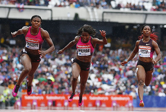 Blessing Okagbare of Nigeria (left) wins the women's 100m, with Barbara Pierre of the U.S. (centre) second and Shelly-Ann Fraser-Pryce of Jamaice (right) fourth, at the London Diamond League 'Anniversary Games' athletics meeting at the Olympic Stadium, in London on Saturday