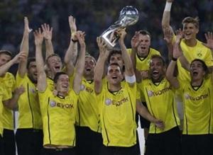 Borussia Dortmund's Sebastian Kehl lifts the German Super Cup trophy