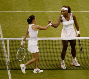 Serena Williams (R) shakes hands at the net with Kimiko Date-Krumm after their match