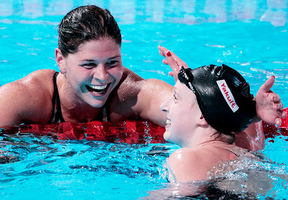 Lotte Friis of Denmark (left) congratulates Katie Ledecky after the women's 1500m Freestyle final