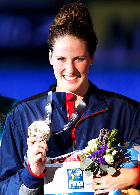 Missy Franklin shows the gold medal after her victory in the women's 100m backstroke final