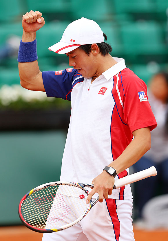 Kei Nishikori celebrates after defeating Benoit Paire on Saturday