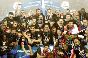 The FC Basel team poses with the trophy after winning the Swiss soccer championship