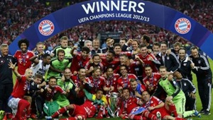 Bayern Munich players and staff celebrate with the trophy after winning the Champions League final