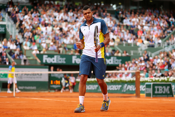 Jo-Wilfried Tsonga of France celebrates a point during his match against Viktor Troicki of Serbia