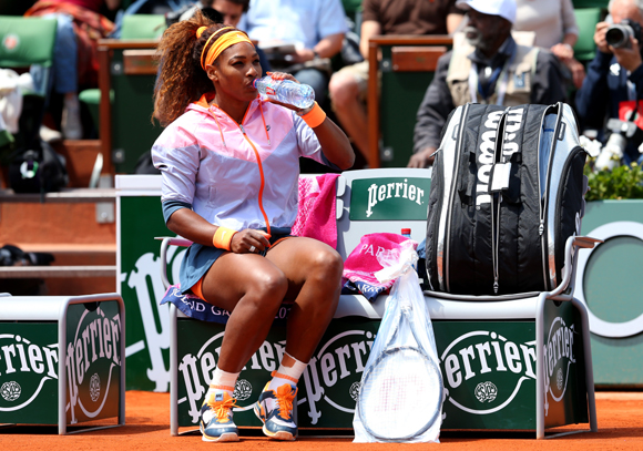 Serena Williams of United States of America takes a break during her match against Roberta Vinci of Italy