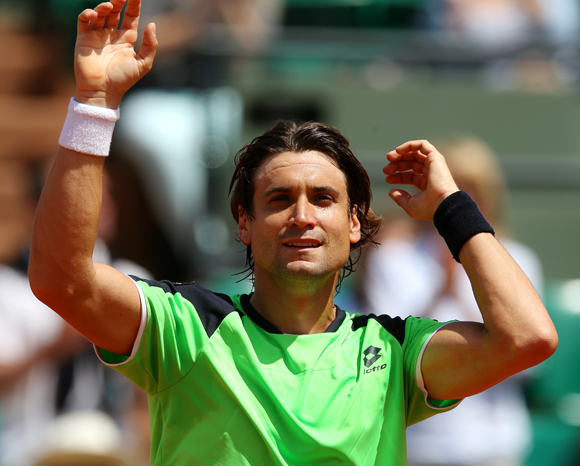 David Ferrer of Spain celebrates match point