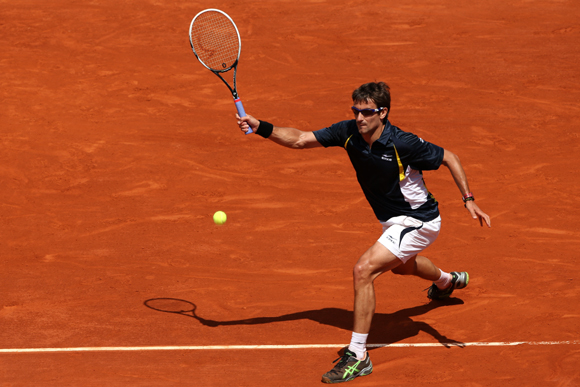 Tommy Robredo of Spain plays a forehand during his match against compatriot Nicolas Almargo