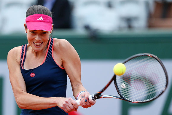 Ana Ivanovic of Serbia plays a backhand during her Women's Singles match against Agnieszka Radwanska of Poland on Sunday