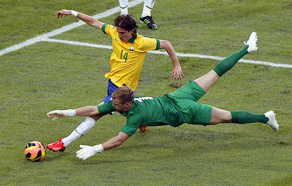 England's goalkeeper Joe Hart (bottom) reaches to deflect the ball from Brazil's Filipe during their international friendly on Sunday
