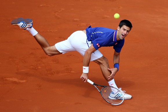 Novak Djokovic of Serbia plays a backhand during his match against Philipp Kohlschreiber of Germany