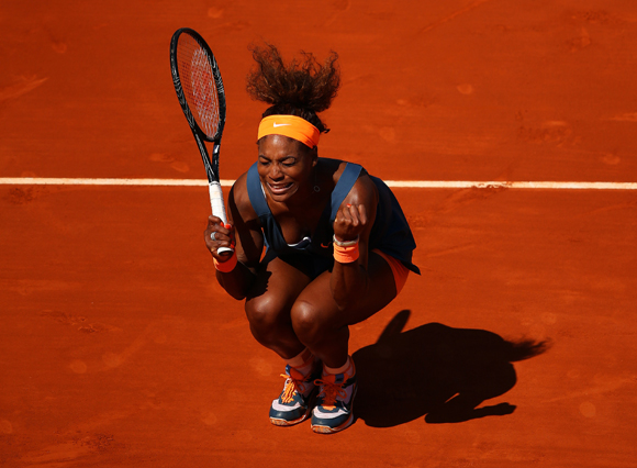 Serena Williams of United States of America celebrates match point during her quarter-final against Svetlana Kuznetsova of Russia