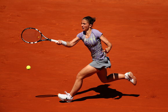 Sara Errani of Italy plays a forehand during her quarter-final against Agnieszka Radwanska of Poland