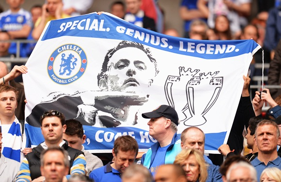 Chelsea fans hold up a banner