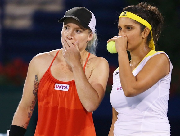 Bethanie Mattek-Sands of USA (right) celebrates with partner Sania Mirza