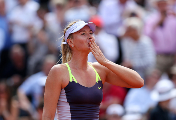 Maria Sharapova of Russia blows a kiss to the crowd as she celebrates match point in her quarter final against Jelena Jankovic of Serbia