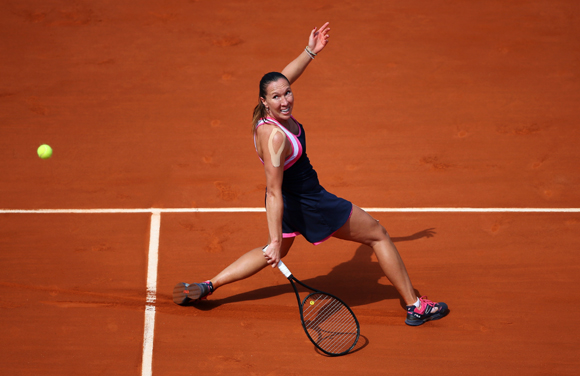 Jelena Jankovic of Serbia plays a backhand during her match against Maria Sharapova of Russia