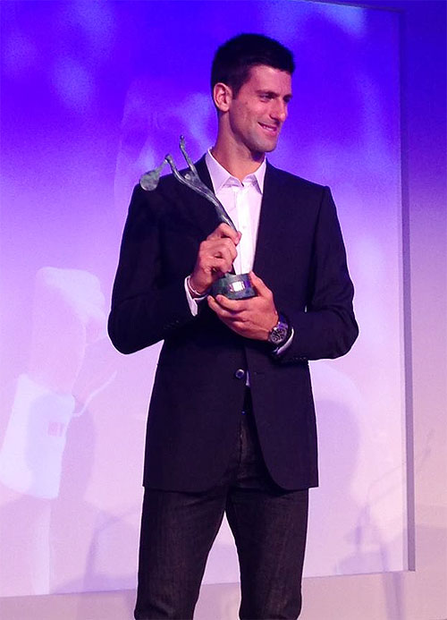 Novak Djokovic with his trophy at the ITF annual Champions Dinner on Tuesday