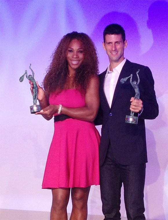 Serena Williams and Novak Djokovic show off their trophies at the ITF Champions Dinner on Tuesday