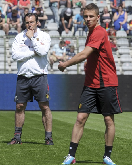 Belgium's coach Marc Wilmots (left) looks on next to   Thorgan Hazard during a training session