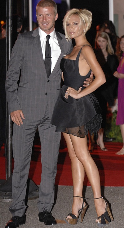 David Beckham (left) and his wife Victoria Beckham