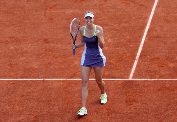 Maria Sharapova of Russia celebrates match point after her semi-final match against Victoria Azarenka of Belarus