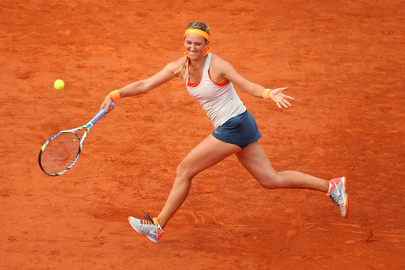 Victoria Azarenka of Belarus plays a forehand in her semi-final against Maria Sharapova of Russia