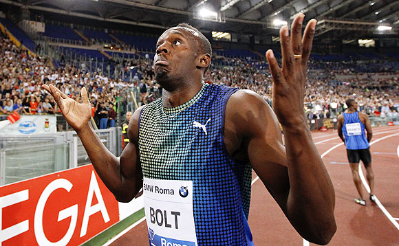 Usain Bolt of Jamaica reacts at the end of the 100m event at the Golden Gala IAAF Diamond League at the Olympic stadium in Rome on Thursday