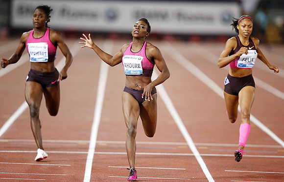 Murielle Ahoure of Ivory Coast (centre) crosses the finish line to win the women's 200m event during the Golden Gala IAAF Diamond League at the Olympic stadium in Rome on Thursday