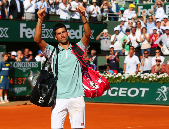 Novak Djokovic of Serbia applauds the fans as he walks off court after losing to Rafa Nadal